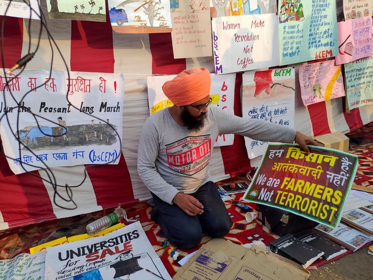 A farmer making placards at the protest site
