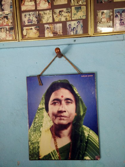A photo of tamasha empress Vithabai Narayangaonkar, Mangala Bansode's mother, hangs in Mangala tai's house in Karawdi village, Karad taluka, Satara district