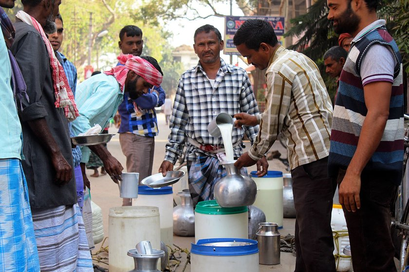Milk producers of char selling milk at Dhubri town
