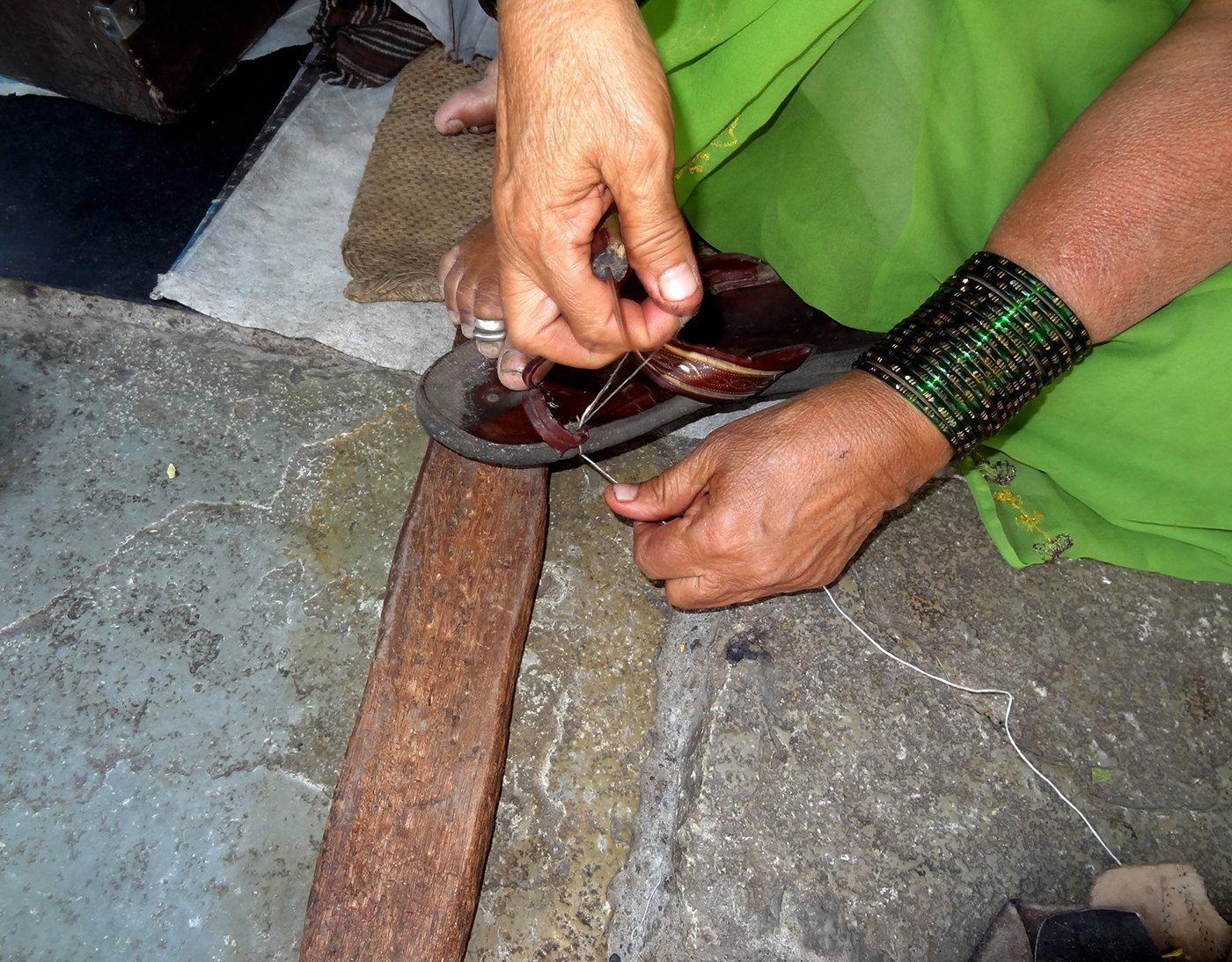 03-Bhamabai_Stitching_DSC01555-NW-Fixing Straps and Mending Soles.jpg