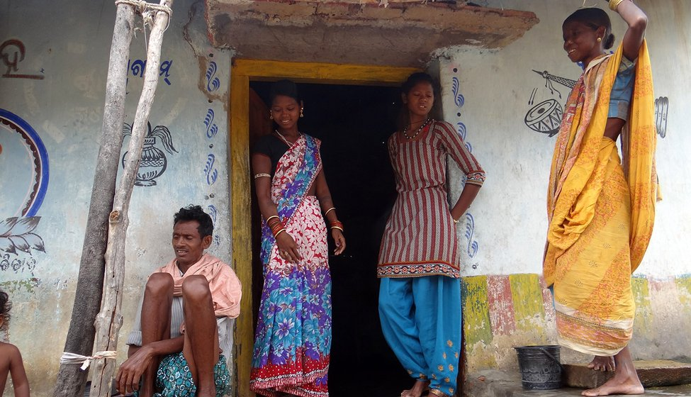 Top: Gundhar's wife Rashmita (standing, left), his sister-in-law, and parents-in-law outside their house in Tukla village