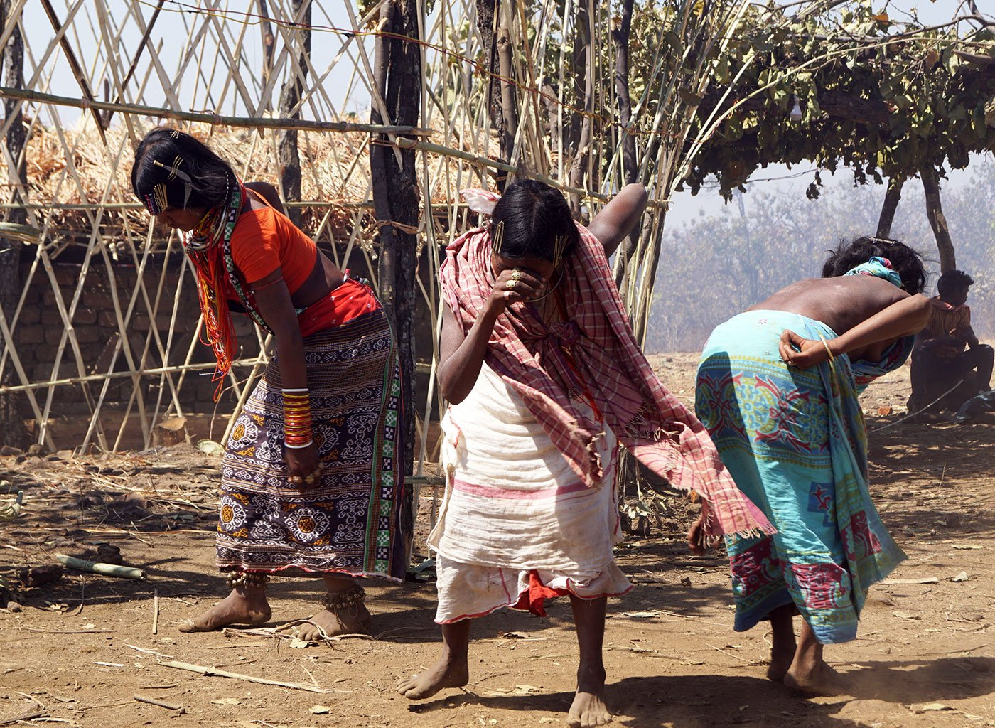 Three tribal women, who are priests, dancing after conducting their rituals