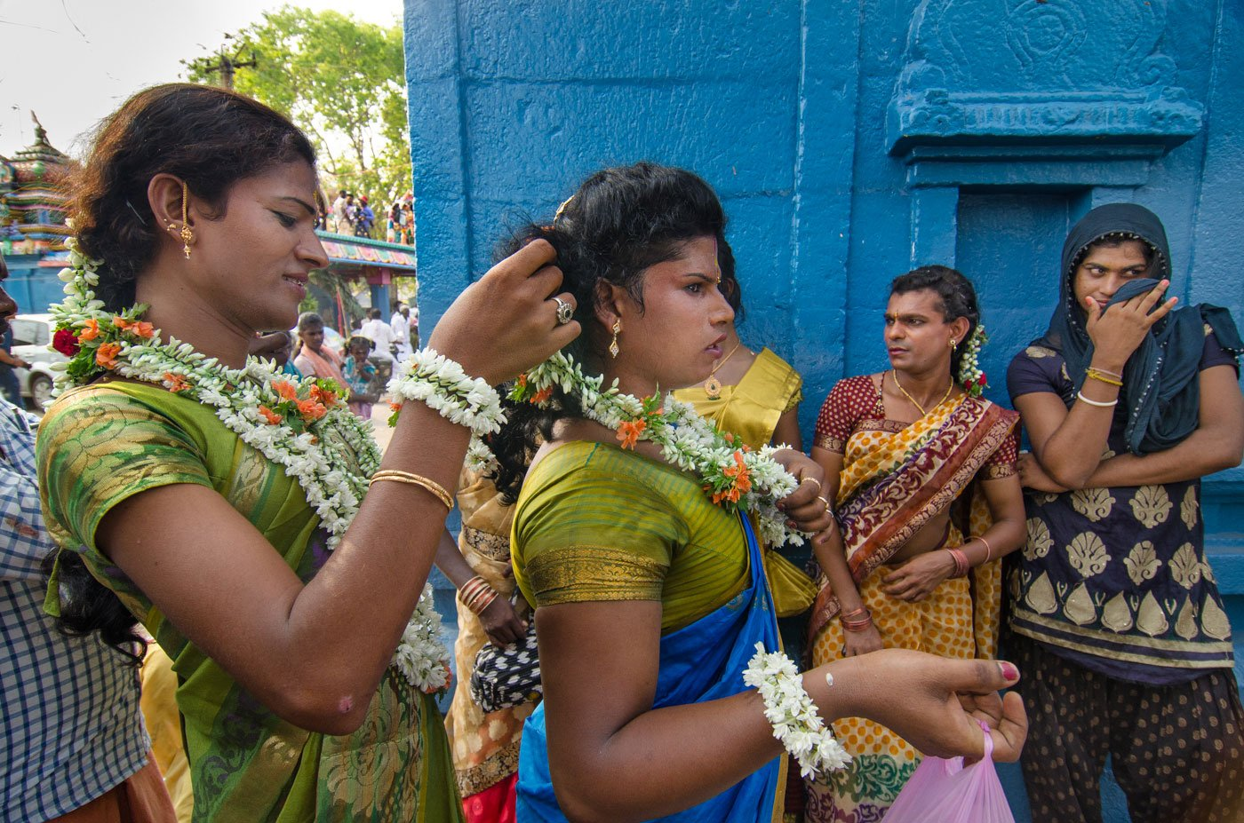 Aravanis enact a story from the Mahabharata in which they get married to Lord Aravan. Here, they are seen getting ready for the wedding. A transgender woman decorating another transgender's hair with flowers