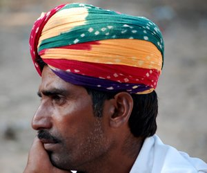 Man with a colourful head gear