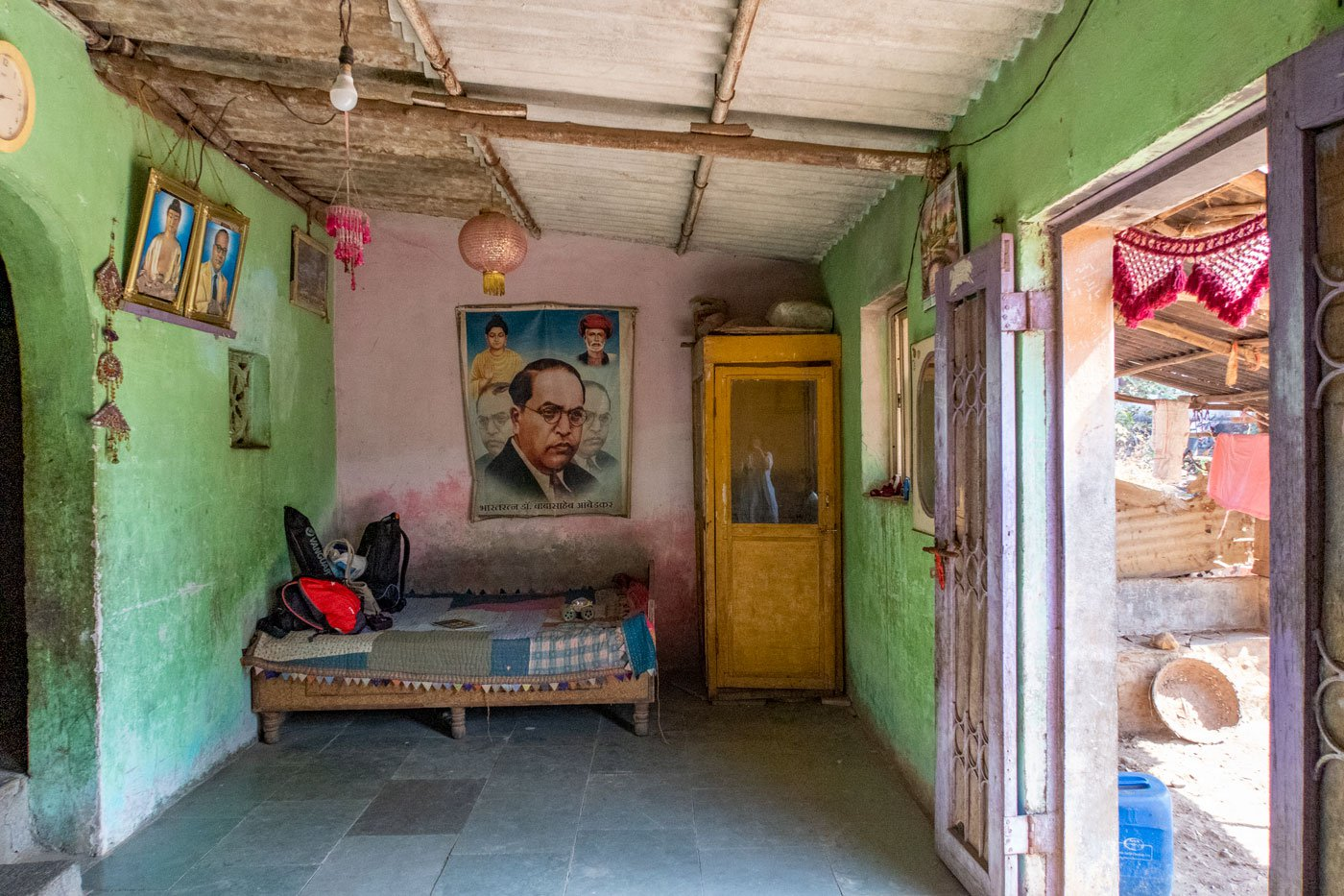 The walls of Kusum Sonawane's home in Nandgaon shows the family's reverence for Babasaheb Ambedkar