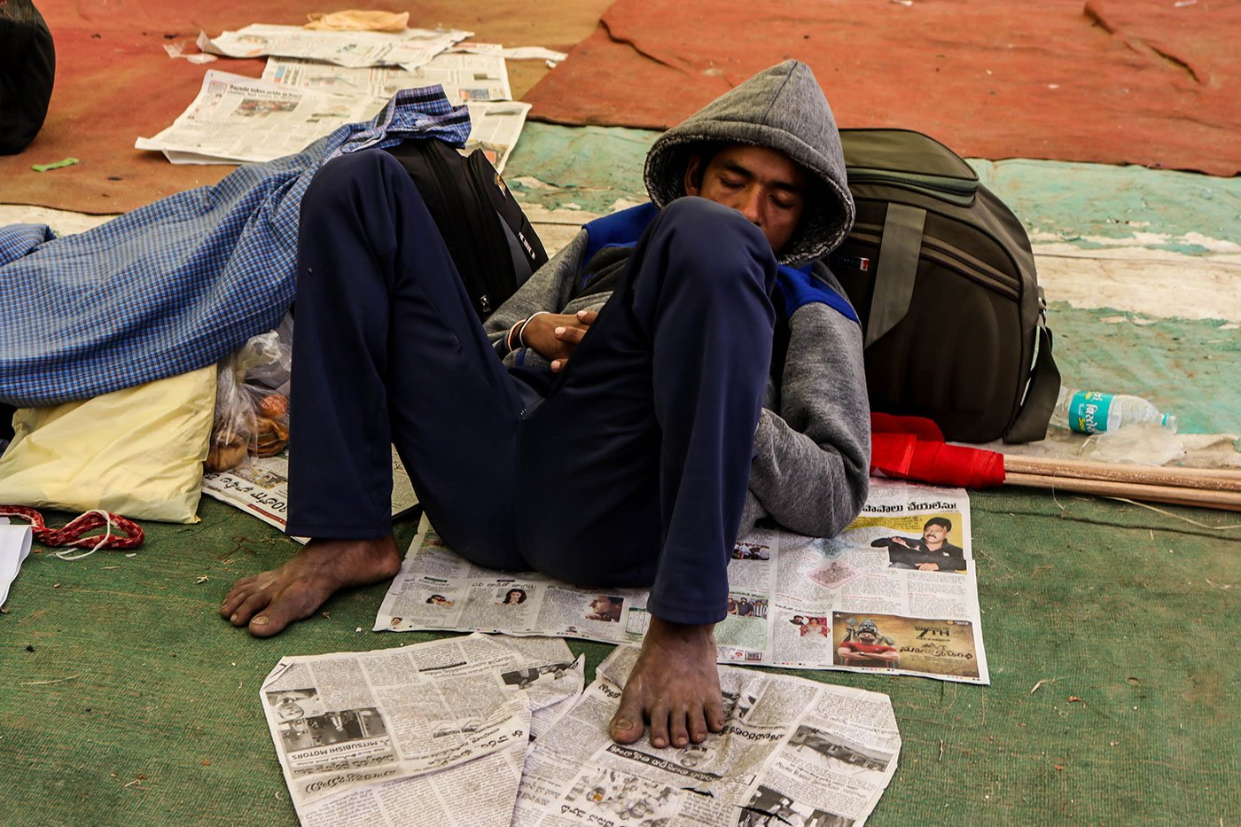 A young farmer sleeping in the Ram Leela Maidan