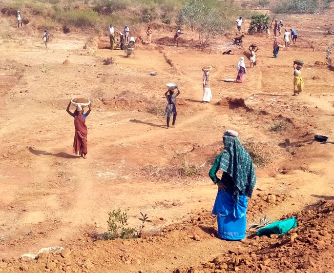 Labourers working in MGNREGA work sites on the outskirts of Munagapaka village