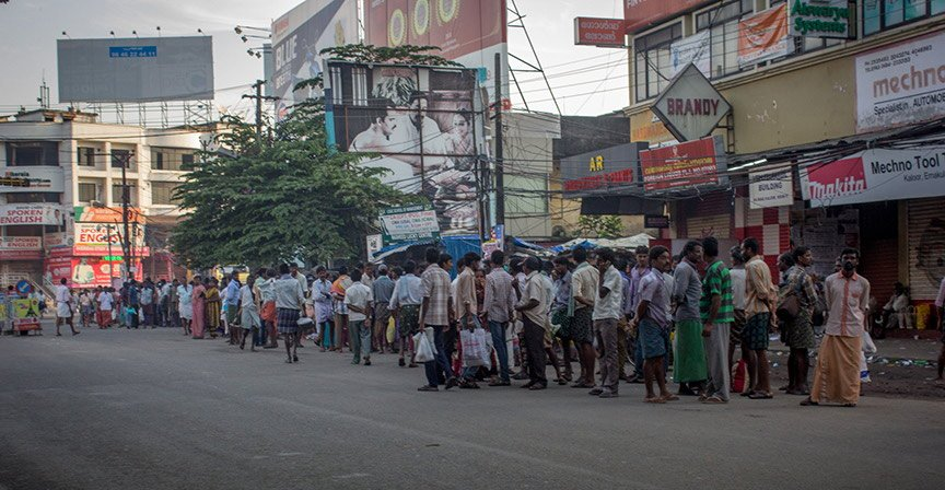 Tamil and Telugu migrants waiting for work in the morning at Kaloor.