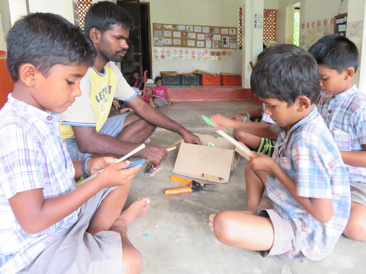 M. Sakthivel teaching children at the Thulir school