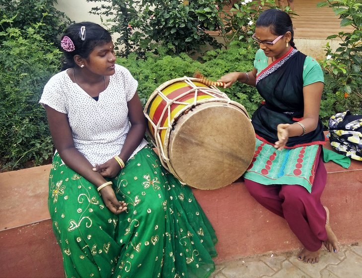 Kavya V (left) and Narsamma S (right) playing the drums