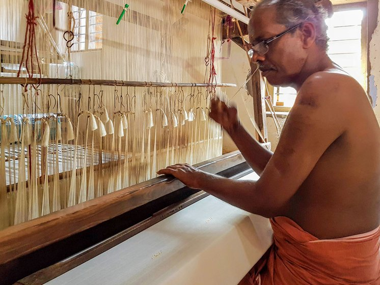 Mani K. who has been in this profession for over 30 years, works on the handloom