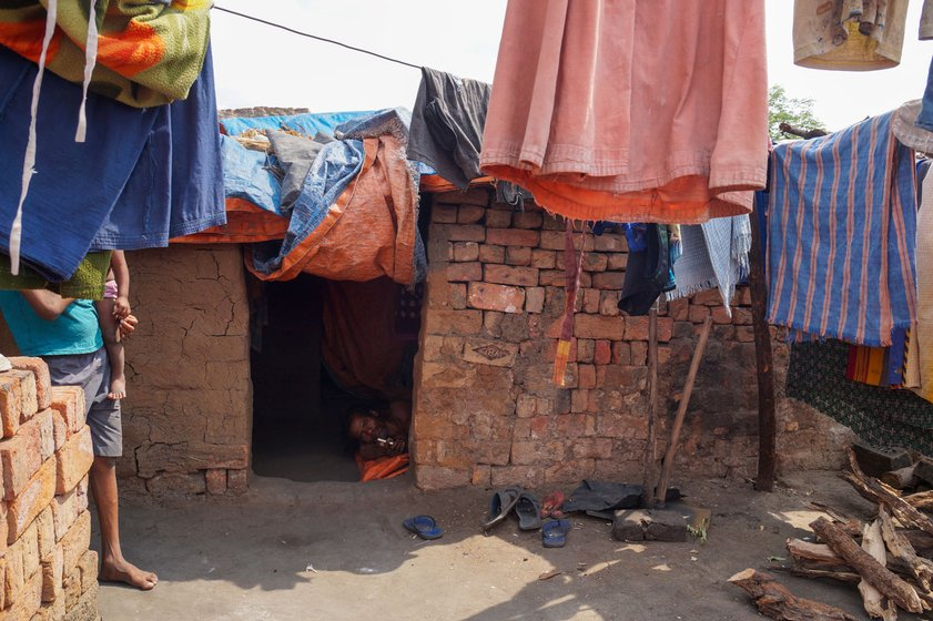 The kiln workers' makeshift huts – around 75 families from Balangir district are staying at the kiln where Hruday works