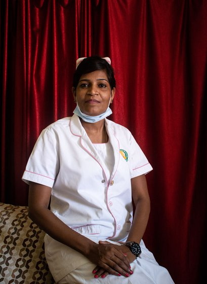The stigma of working in a Covid ward, for nurses who are Dalits, as is Thamizh Selvi, is a double burden. Right: 'But for my husband [U. Anbu] looking after our son, understanding what my role is, this would not have been possible'