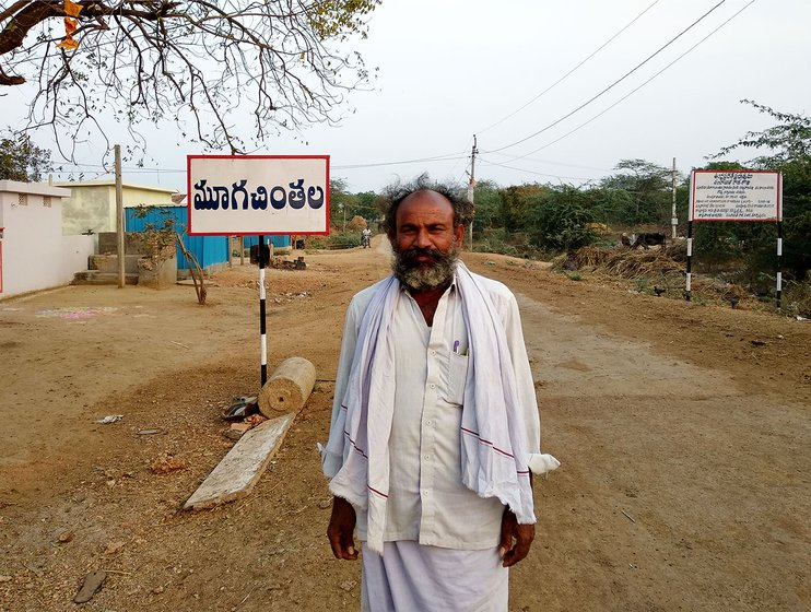 A farmer standing on a road