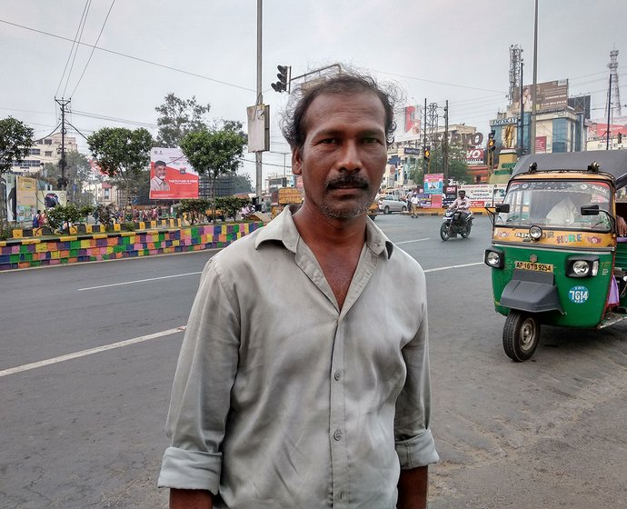 A man standing on a street in Vijaywada