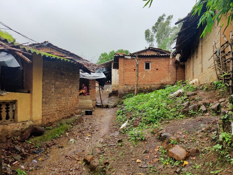 The lane to Dilip's house (left) in Kadvyachimali hamlet (right), with houses whose residents migrate for work every year