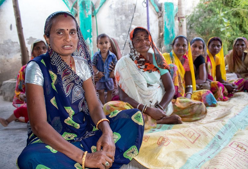 Kalpana Rawal (blue saree) is leading a women's group in her village to promote women's health