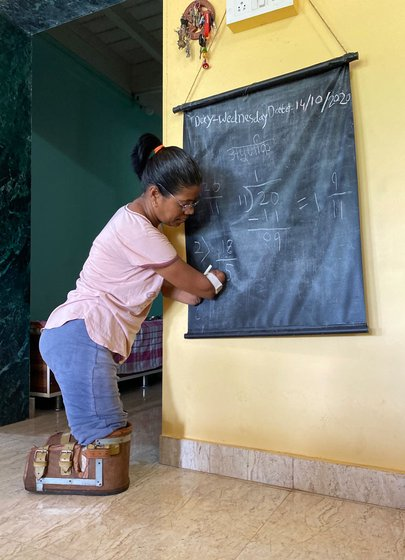 'When the doctors first told me about the operation I went into shock... Since then, every small task takes longer to complete. Even writing with this chalk is difficult'