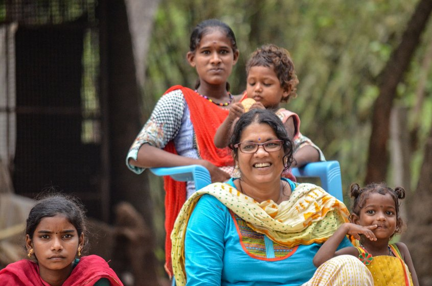 Prema Revathi (left) with some of Vanavil's residents. Most of the school's students have been sent home, but a few remain on the campus (file photos)