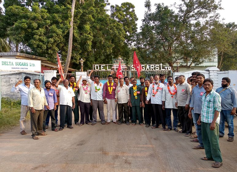 Workers protesting in front of the main entrance of the Delta Sugar Mills facing the National Highway
