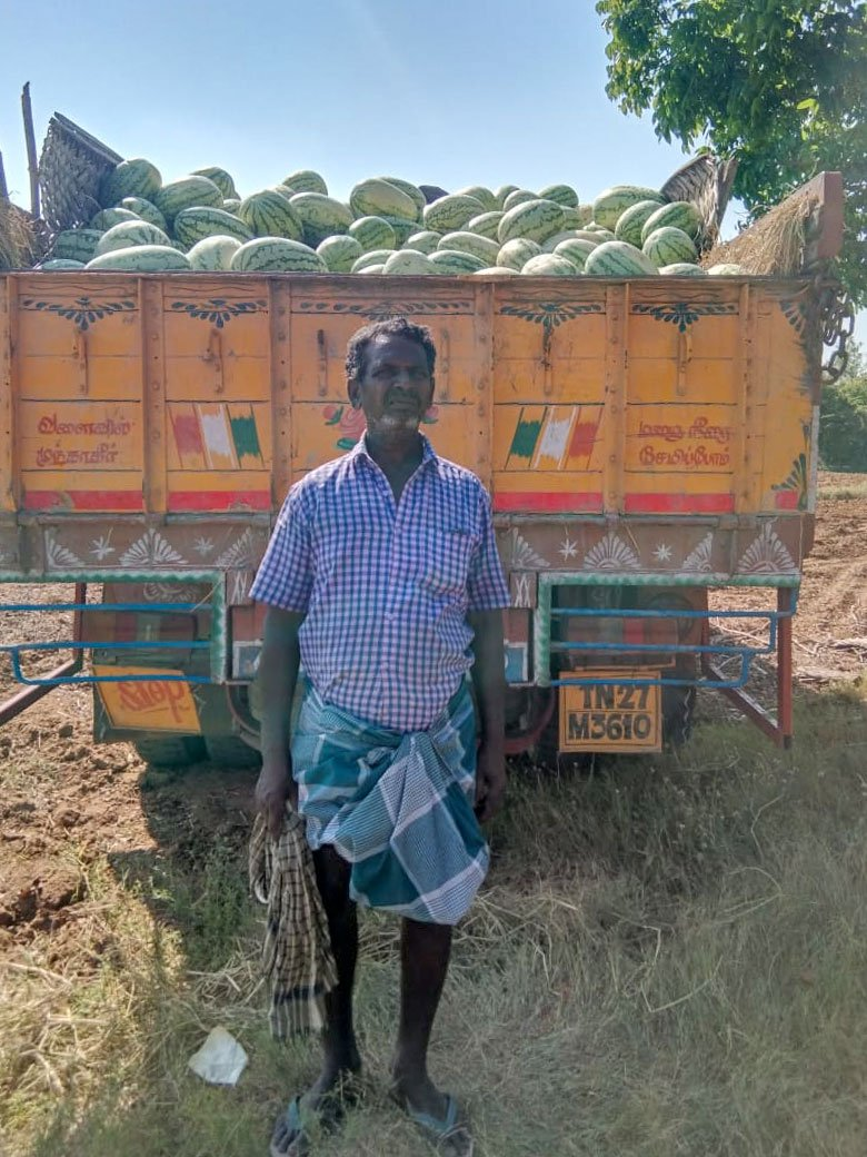 A farmer near Trichy with his watermelons loaded onto a truck. A few trucks are picking up the fruits now, but farmers are getting extemely low prices