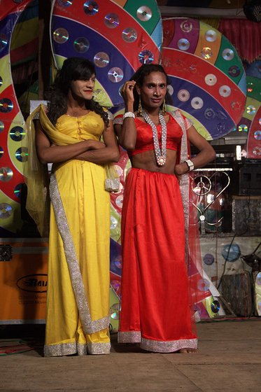 Male artists dressed as women during the performance in Gogolwadi village, Pune district