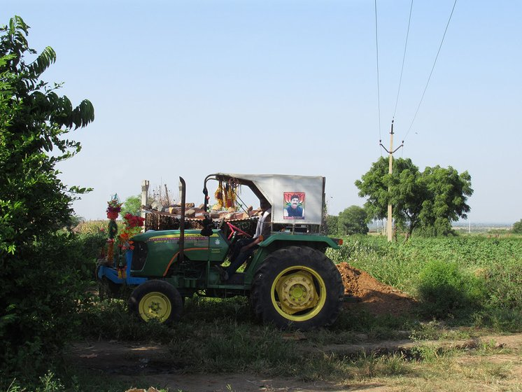 A tractor parked near sugarcane field