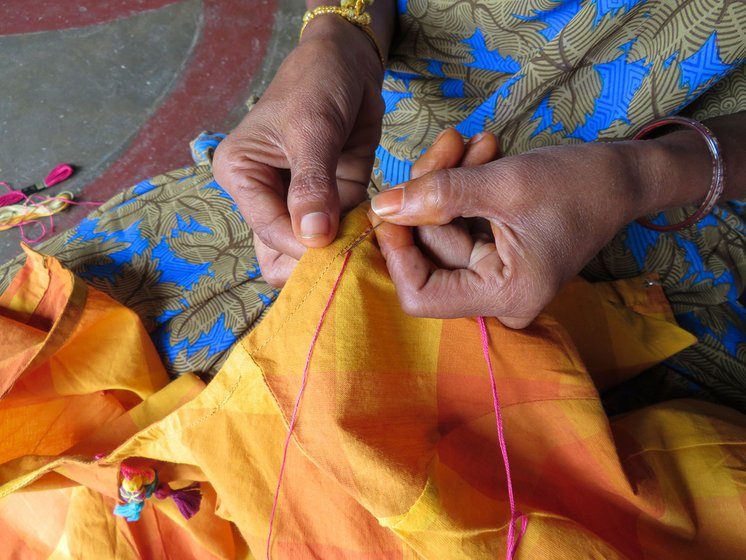 Woman stitching a design