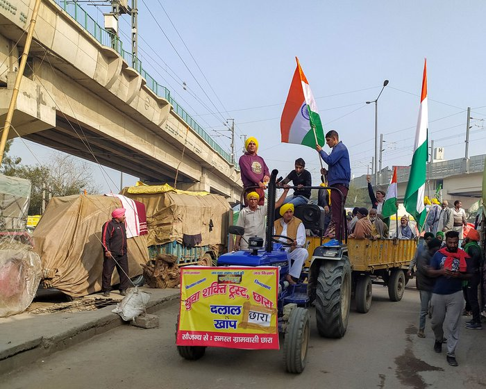 Left: A convoy of truck from Bathinda reaches the Tikri border. Right: Men from Dalal Khap preparing for the tractor parade