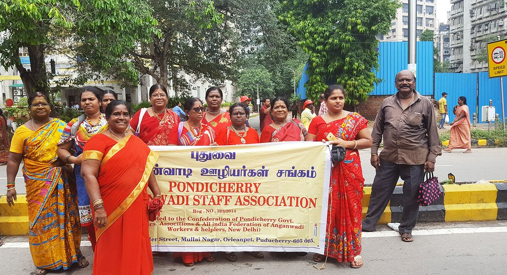 Tamilarasi (front) and her colleagues from the Pondicherry Anganwadi Staff Association, pose for a cheerful picture, after recounting their grievances over the rapid informalisation of anganwadi workers