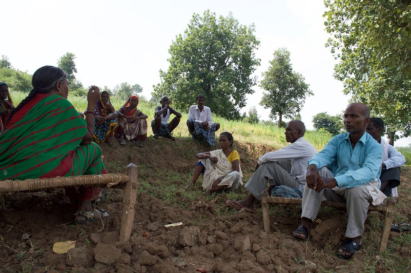 Rajkumari leads a community meeting in her village
