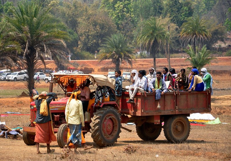 People sitting in a tractor to participate in Jatra
