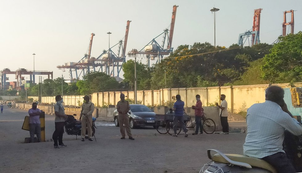 Left: The Fishing Harbour in Visakhapatnam (file photo). As of April 2, 2020, fishermen were officially not allowed to venture out to sea. Right: The police has been guarding the entrance to the jetty and fish market during the lockdown