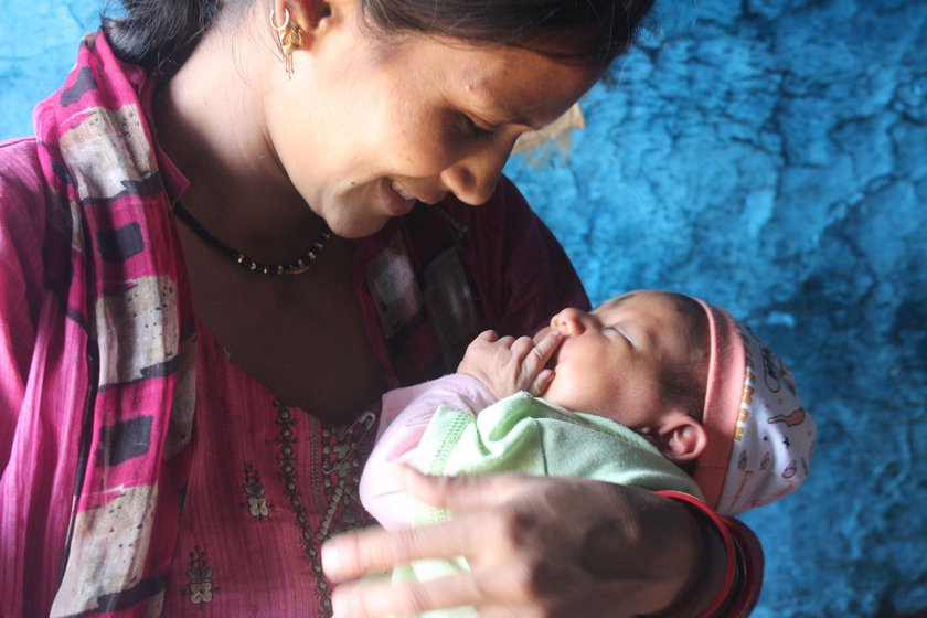 Manisha Singh Rawat gave birth to her daughter (in pram) at home, assisted by a dai or traditional birth attendant