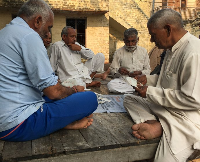 Only men occupy the chaupal at the village centre in Harsana Kalan, often playing cards. 'Why should women come here?' one of them asks