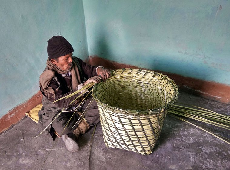 The man has finished weaving his basket