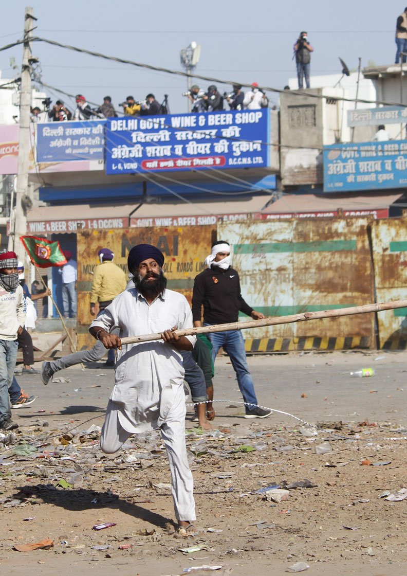 November 27: 'When protestors block a road or damage it, they are branded as criminals. What if governments do the same? Are they not what they call us?' asks 70-year-old Harinder Singh Lakha (not in these photos) from Punjab's Mehna village
