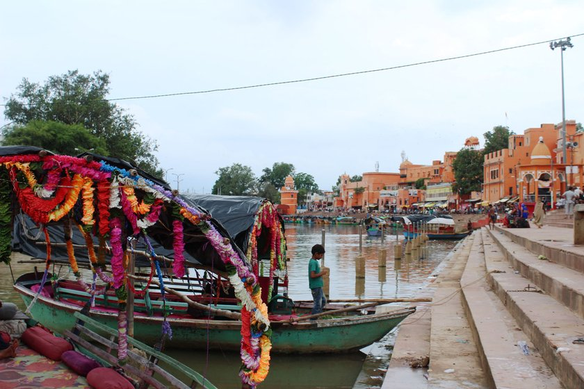 Left: Ramghat on the Mandakini river, before the lockdown. Right: Boats await their riders now