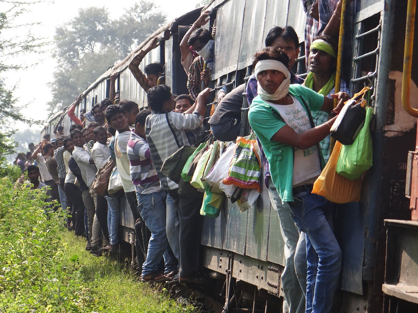 'Usually there is no space in the bogie and people hang outside the doors', says Pradeep Sahu