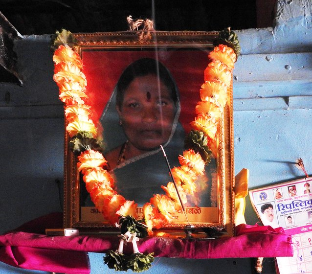 Framed photo of Shahu Kamble with garland