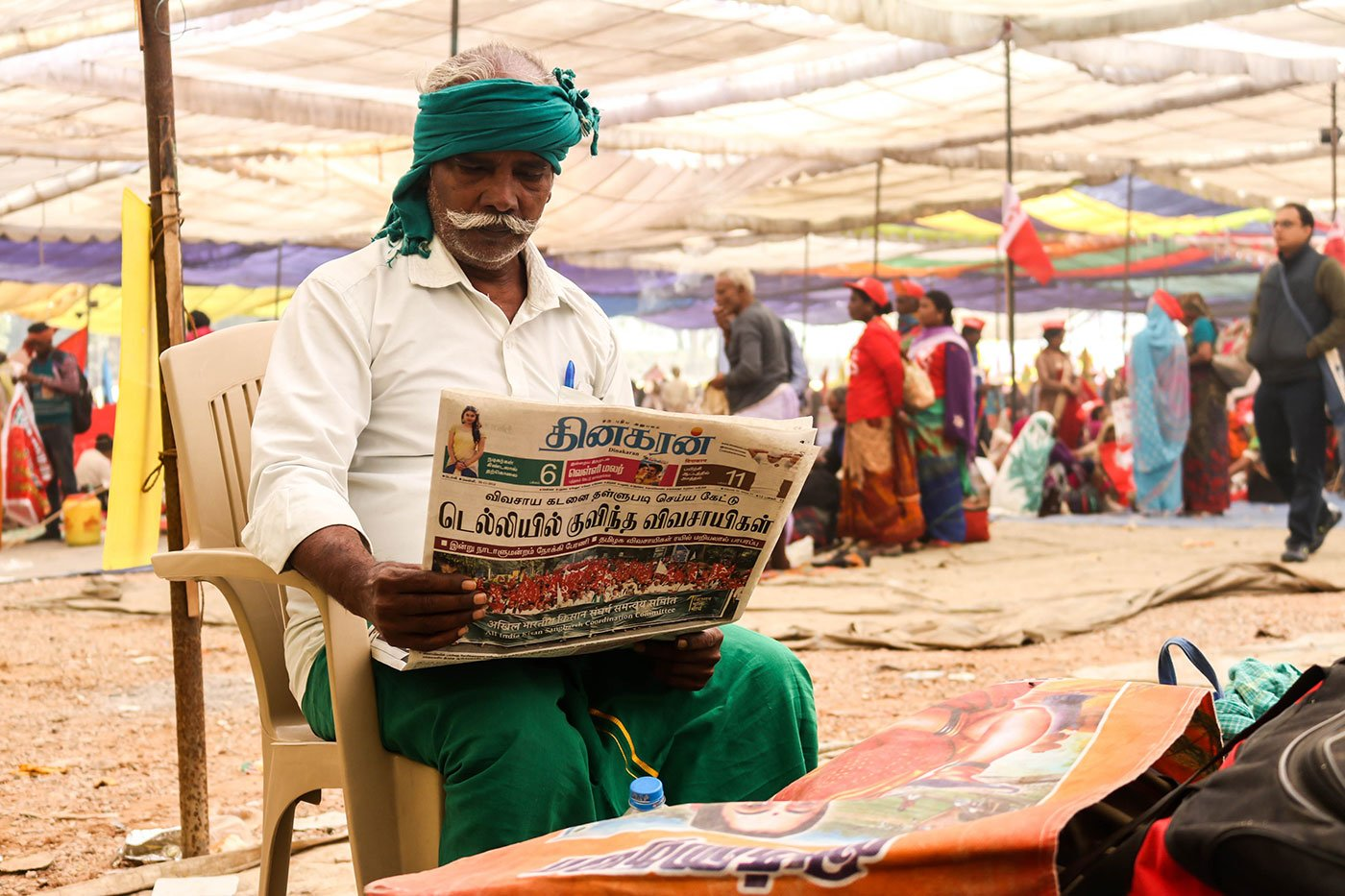 Kodanda Raman, 62, a farmer from Kanjankollai village in Kattumannarkoil taluka of Cuddalore district in Tamil Nadu reading the Tamil Newspaper to see if they had covered their story on the March towards Ramlila Maidan
