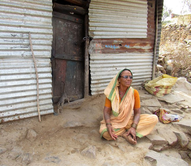 A woman sitting outside a tin hut in Hatkarwadi village in Beed district of Maharashtra