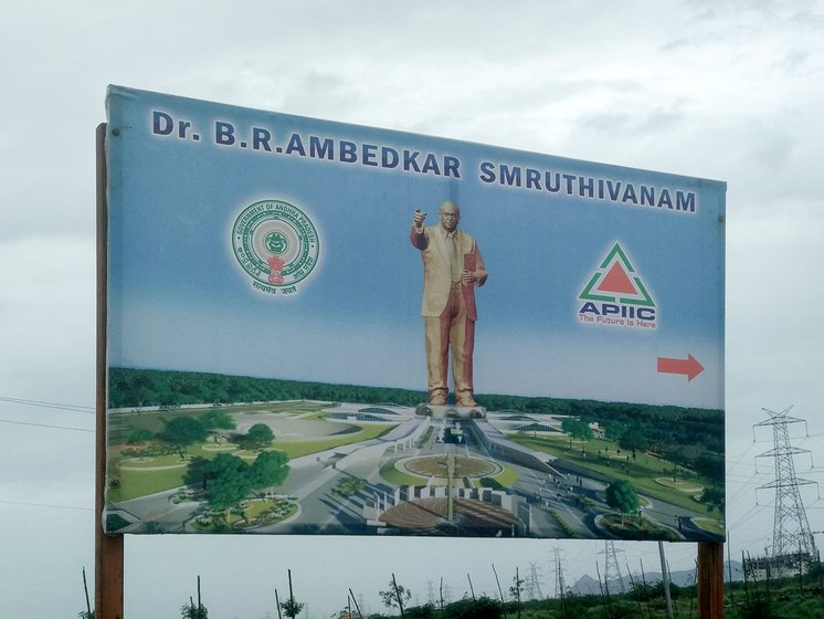 A signboard showing the directions to the yet to be constructed Ambedkar Smriti Vanam