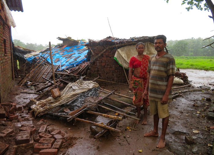 Bala and Gauri Wagh outside their rain-damaged home in August 2019