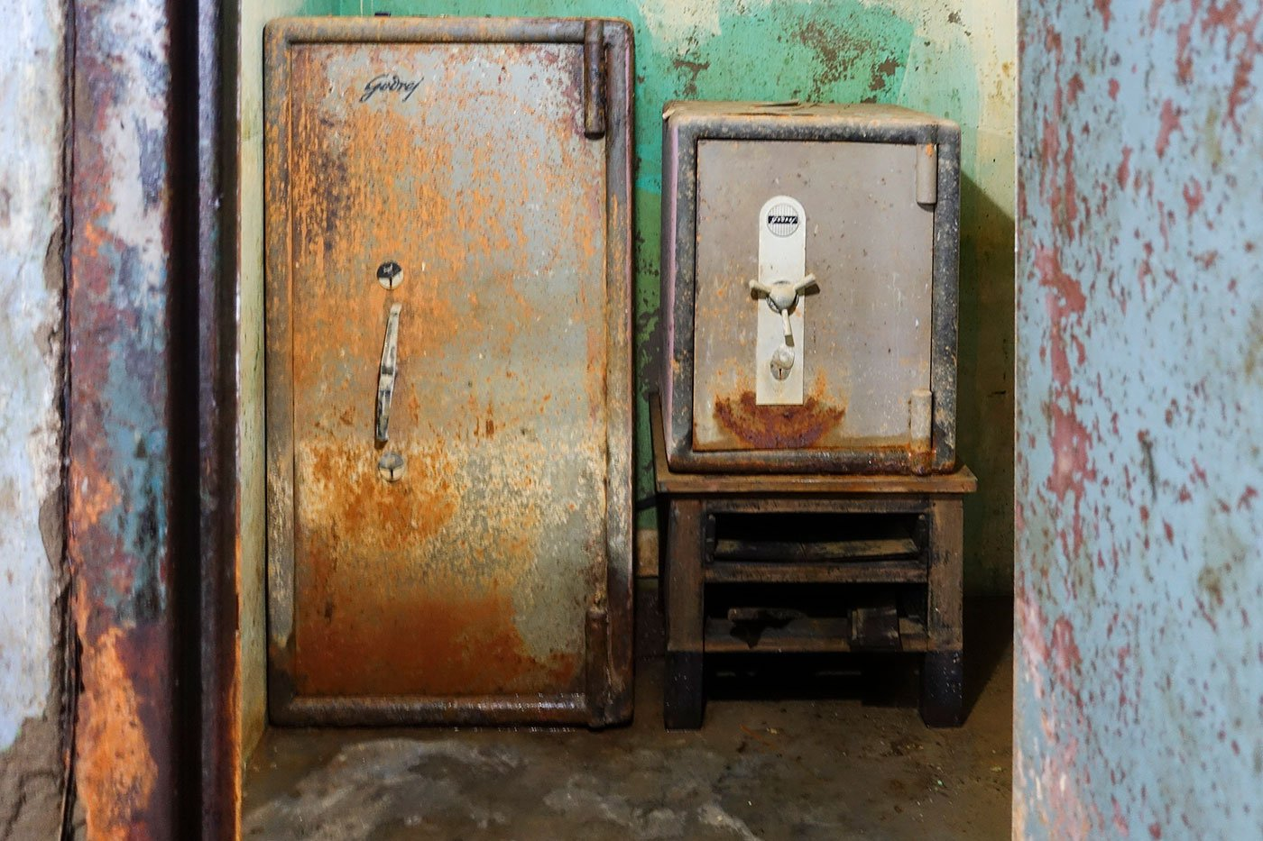 Two cast-iron safes bear the rust, corrosion and marks wrought by the waters that engulfed them.
