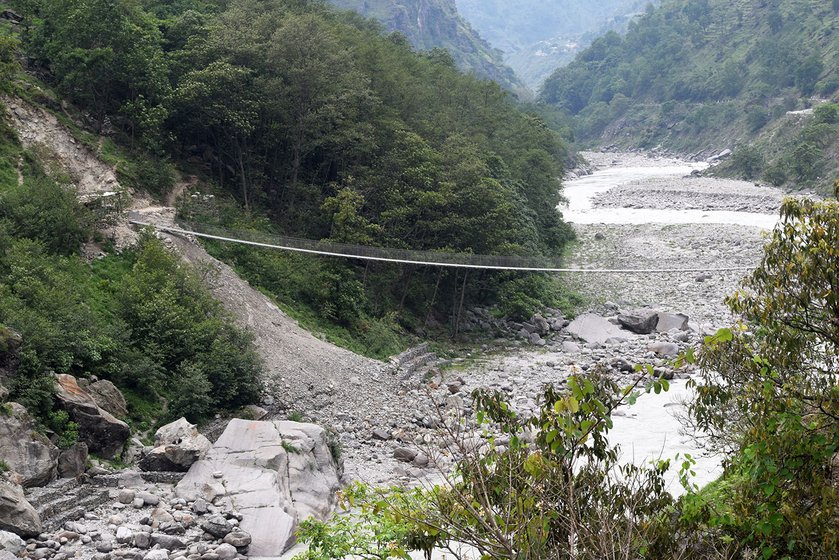 A footbridge hangs connecting the two nations of Nepal and India.
