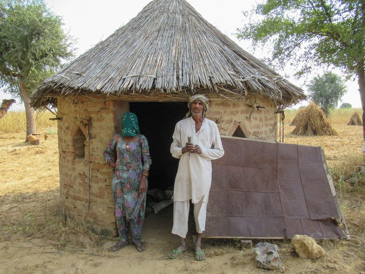 Bajrang Goswami and Raj Kaur (left) say their 'back has burnt with the heat', while older farmers like Govardhan Saharan (right) speak of the first rains of a different past