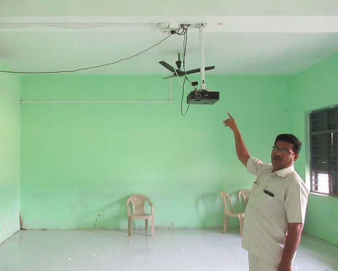 Bashir Tamboli pointing to projector that can't be used