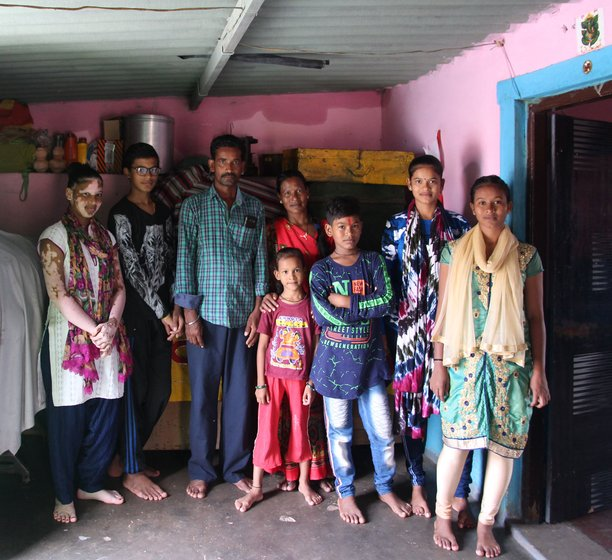 Left: Chandni with her parents and siblings at their home. She is the oldest of four sisters and two brothers. Right: Chandni and Asha with Asha's parents, brother, niece and a neighbour, at Asha's home