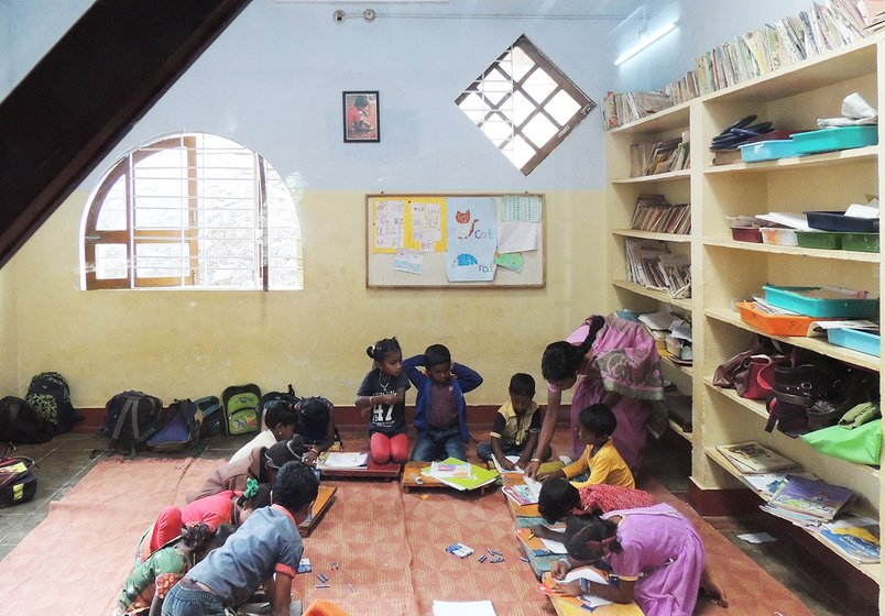 Adivasi children learning in a classroom